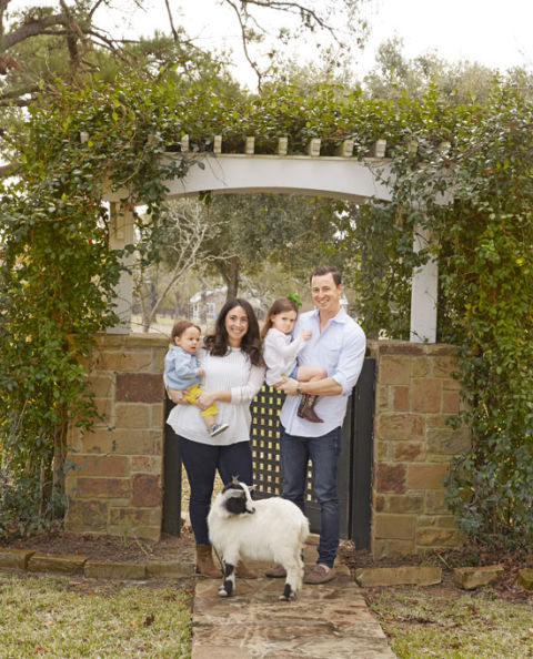 """We want our house to be comfortable and inviting, without being fancy or fussy,"" says Bailey. ""This is where were come to unwind, reconnect, and build memories as a family."" In this photo: Bailey and husband Pete pose with son Harry, 11 months, daughter Grace, 3 (not a fan of posing for family pics!), and their goat, Calamity Jane."