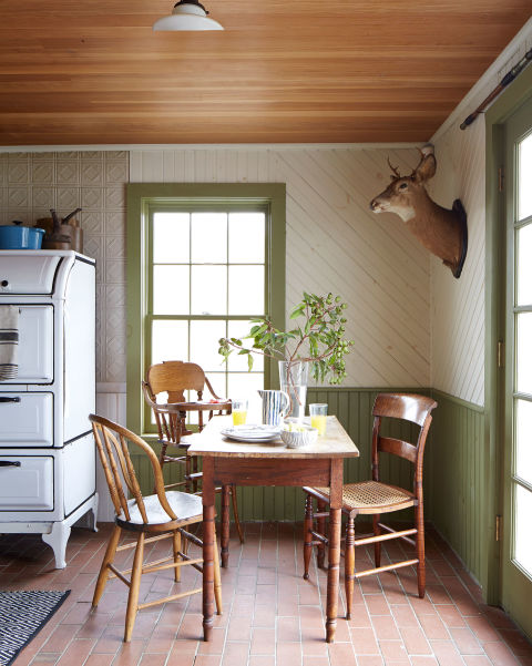 The kitchen of this historial Catskills home features an oak table and mismatched chairs that are flea-market finds; the turn-of-the-century high chair (used by the couple's 18-month-old son, Charlton) is a hand-me-down from a friend.<br />