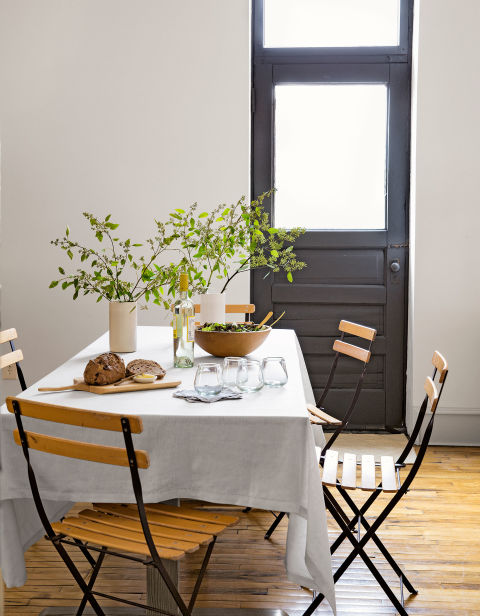 Folding cafe chairs from Smith & Hawken take up little space in the tiny dining area of this Minneapolis loft. The owner spruced it up after being inspired by her family's farmhouse.<br />