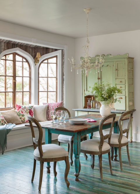 The owners of this Arkansas home saved only the pieces of original furniture with potential or items that were stunning as is, like the sage cupboard and the chippy dining table.<br />