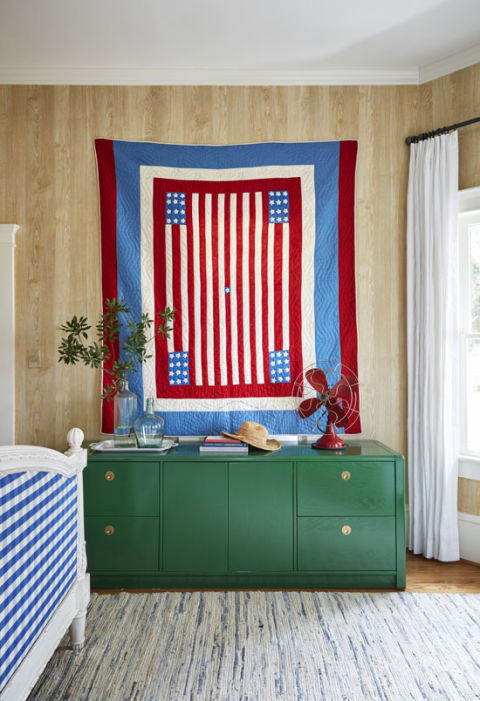 """""""As someone who's dabbled a bit in sewing, I truly appreciate the artistry and craftsmanship,"""" says Bailey of her antique quilts.  RELATED: 6 New Ways to Use Tattered Old Quilts"""