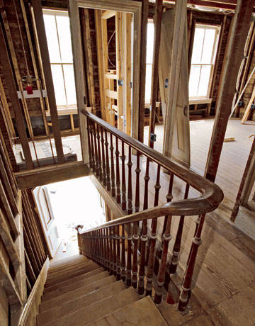 Attractive Original Wooden Staircase Leading To Renovation Work Upstairs