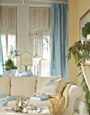 White Living Room With Blue Curtains