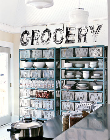 Awesome Blue Metal Shelves Hold Bins Dishes Water And Potatoes With A Sign That  Says Grocery Above