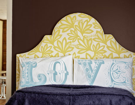 A cheerful floral and dragonfly fabric brightens up an elegant headboard.