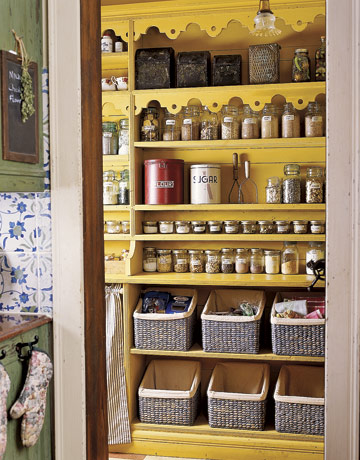 Yellow Shelves With Many Jars