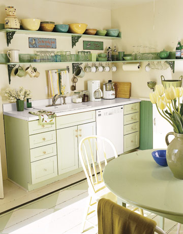 Open Shelves In A Light Green Kitchen