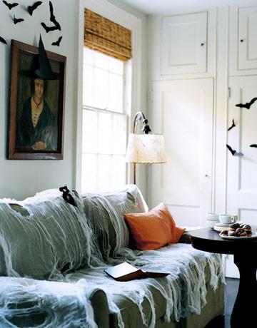 sofa with spiderwebs - Restoration Hardware Halloween