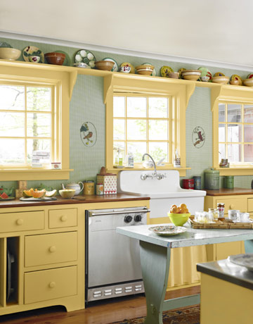 kitchen with yellow cabinets and trim