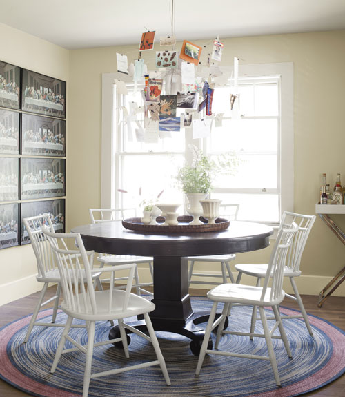 dining room with round table and modern chandelier - Cottage Decorating