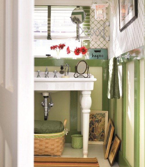 green bathroom with white sink