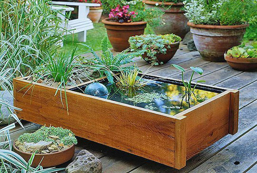 8 diy outdoor fountain ideas how to make a fountain for for Diy garden pond ideas