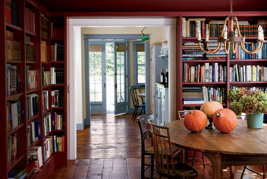 Richard and Bob preserved as many original elements as possible, including the pumpkin pine floors. Richard put a small addition on the house, composed of the bar and family room seen through the doorways. He also requested bookshelves to line the dining room, giving the room a dual purpose, to house his library of Second World War history books.  RELATED: 20 Brilliant Ideas for Bookshelves