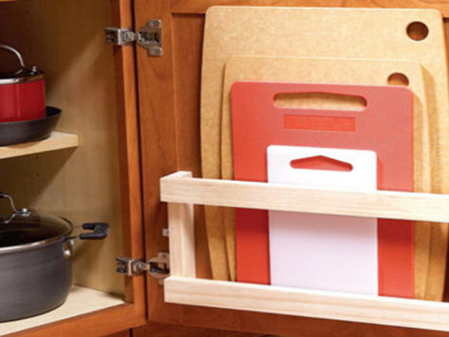 Before you chop and dice your way to all your festive fixings, get your cutting boards out of a cumbersome stack and in to an easy-to-access space. Lifehacker shows how to mount a magazine rack on the inside of a cabinet door to house boards of various sizes. Get the tutorial at Lifehacker.