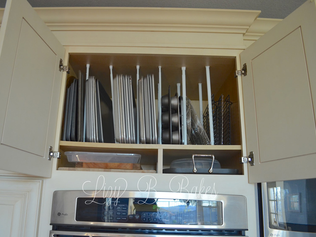 Baking dozens of Christmas cookies again this year? Use tension rods set vertically inside cabinets like Lizy Bakes to make cookies sheets easy to slide in and out. Get the tutorial at Lizy Bakes.