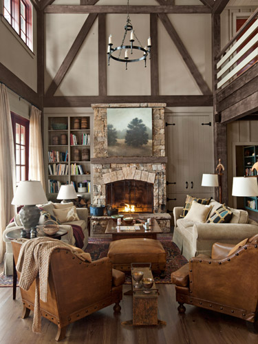 French leather club chairs from Wyatt Childs, plus a pair of Mitchell Gold   Bob Williams sofas, serve up plenty of cozy seating in this Georgia lake house.