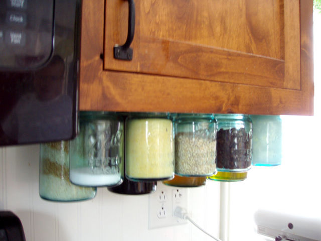 Keep recipe staples at hand, but off the countertop, to minimize trips to the pantry as you make dish after dish—after dish. Post Road Vintage shows how to hang Mason jars filled with regularly needed cooking supplies under cabinets. Get the tutorial at Post-Road Vintage. RELATED: 101 Kitchen Design Ideas