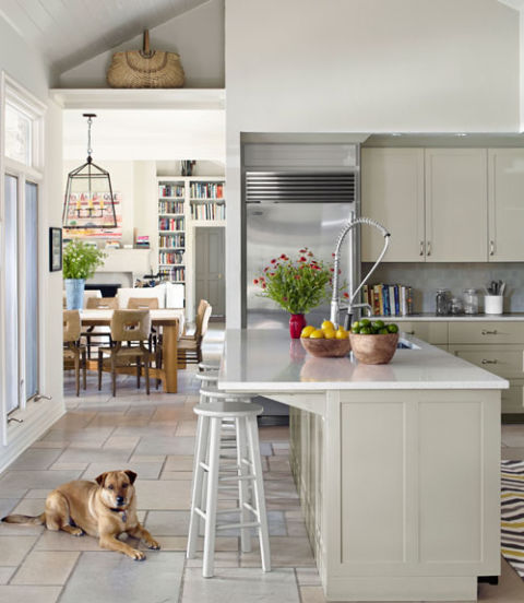 The owners of this Texas ranch painted their kitchen island Paris Rain by Benjamin Moore and topped the counter with Caesarstone.