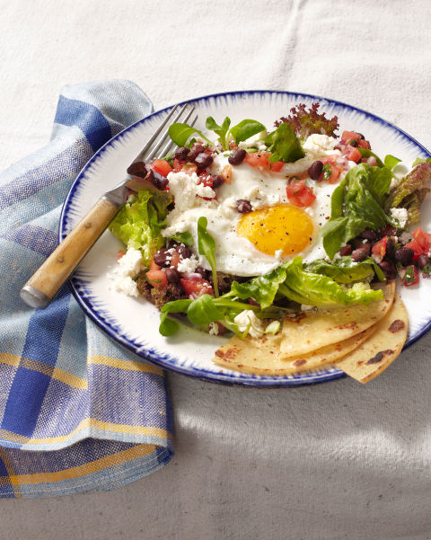 A bright, sunny-side-up fried egg steals the show on this Southwestern salad topped with queso fresco, cilantro, and a citrusy black-bean-and-tomato salsa. Recipe: Huevos Rancheros Salad