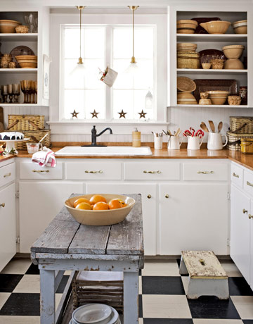 In the kitchen of this Connecticut home, a vintage table serves as a prep island.