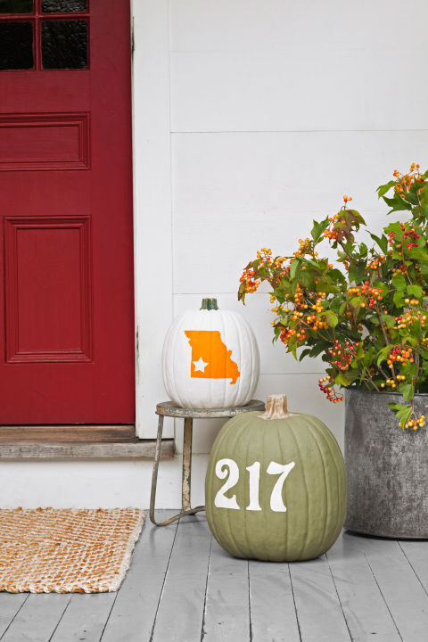 Let revelers know they're at the right address by emblazoning your house number—and hometown—on pumpkins. First, you'll need number stickers ($8 for four; etsy.com/shop/doodlebugdesignstn), as well as a decal in the shape of your state ($4.99; vinyldecals.com). Use Fiskar's star punch ($11.50; amazon.com) to mark your location on the state decal. Apply it to one pumpkin, and the numbers to another, then use a foam brush to cover both pumpkins with two coats of acrylic paint, allowing 30 minutes of drying time per coat. Remove the decals and discard. If you'd like the numbers or state to be a different color than natural pumpkin orange, fill in using a small paintbrush and contrasting acrylic paint, as we did for the green-and-white pumpkin.