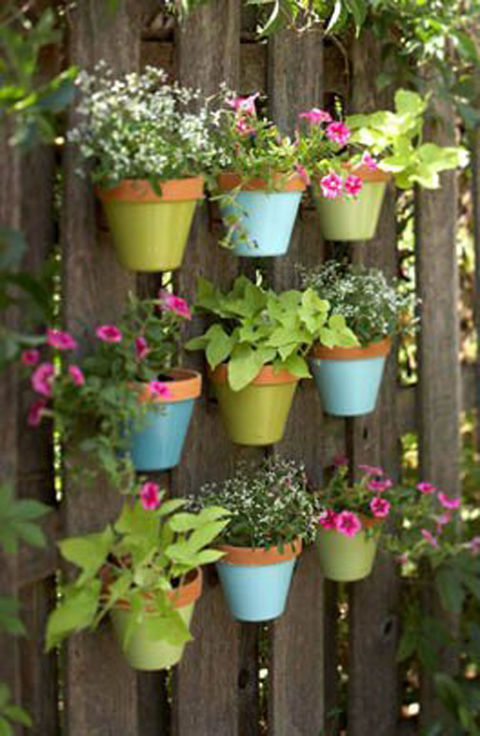 Paint terra-cotta pots in bright spring colors and hang them from your garden fence for a garden view that will make you smile. Get the tutorial at Apartment Therapy.