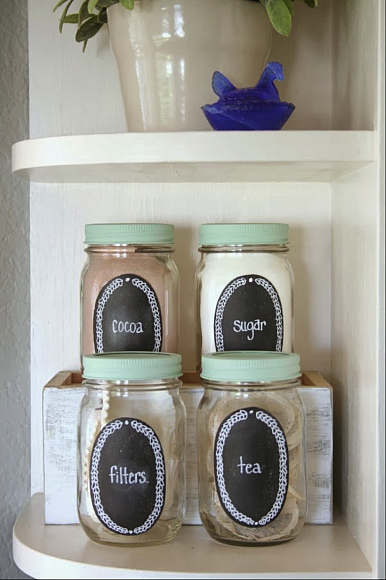 Paint a small section of your Mason jars with chalkboard paint to create labeled countertop storage. Get the tutorial at DecoArt Blog.