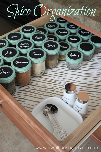 Trade in your spice rack for a spice drawer, equipped with the labeled mason jar tops. Get the tutorial at Dwellings DeVore.