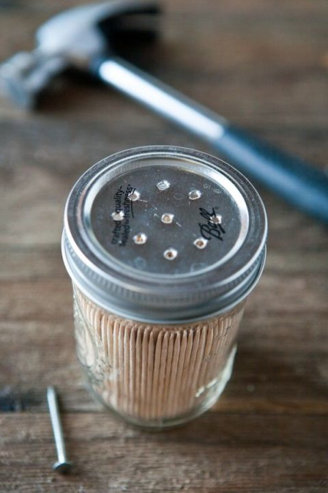 Ideal for the finger food at your next dinner party, this toothpick dispenser can be made by simply poking holes in the lid of a small jar. Courtesy of Eclectic Recipes.