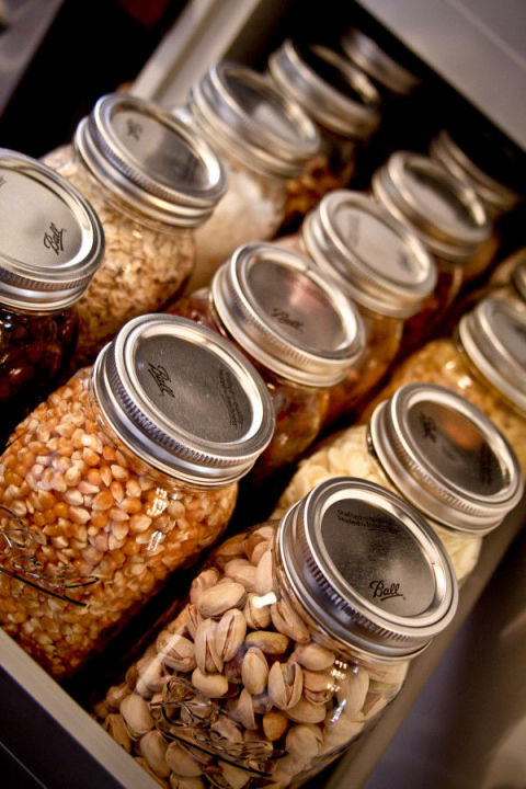 Store dry goods in quart-sized Mason jars for a cute and fun way to organize your pantry. Get the tutorial at Our New House.