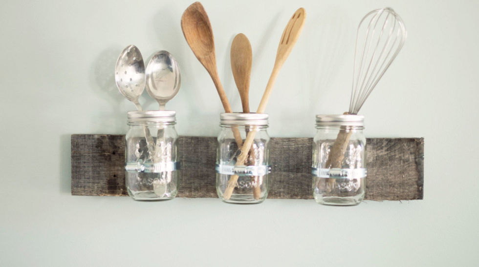 Keep your kitchen utensils organized in this Mason jar wall unit, complete with a wooden back made of reclaimed barn wood. Mason Jar Wall Organizer, $32.99; etsy.com