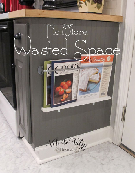 Keep food magazines handy by installing a holder on side cabinets or an island. This area is too low to store items you use regularly, but is great for items that might otherwise get lost in the shuffle. See more at White Tulip Designs »