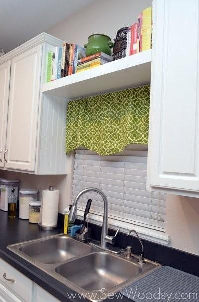 Cookbooks are so handy and cute, but who has space for them? Add a floating shelf on top of your cafe curtains to keep them nearby without using up valuable cabinet space (or blocking natural light). See more at Sew Woodsy »