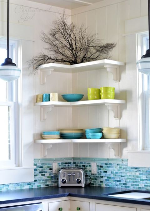 Floating shelves are super adaptable and can fit anywhere — even in an inconvenient corner between two windows. Placing bulky cabinets in this space would have eaten up the storage potential – and now the prettiest bowls and plates add to the room's decor. See more at Centsational Girl »