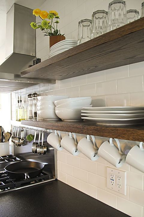 We love open shelving, but forgetting to use the underside is a common mistake. Hang mugs underneath to eke out every drop of storage. See more at Montana Prairie Tales »