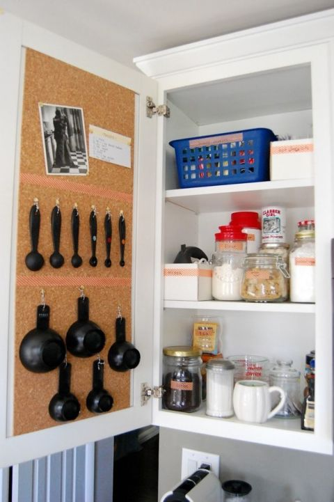 Use a cork board and pins to keep all your baking supplies in order. Flour and sugar sit inside, while measuring utensils hang from string on the opposite door and make baking a breeze. See more at My So Called Life »