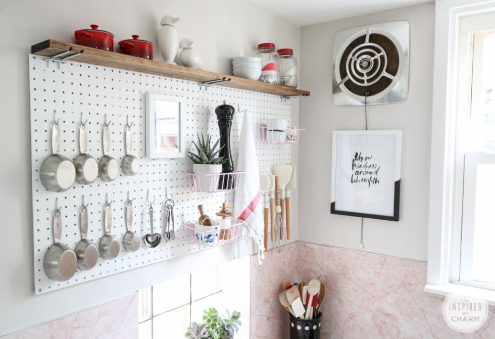 Seriously, no empty space should go unused. A pegboard lets you mix-and-match storage options based on your needs: Hooks for smaller items or cubbies for larger ones. See more at Inspired by Charm »