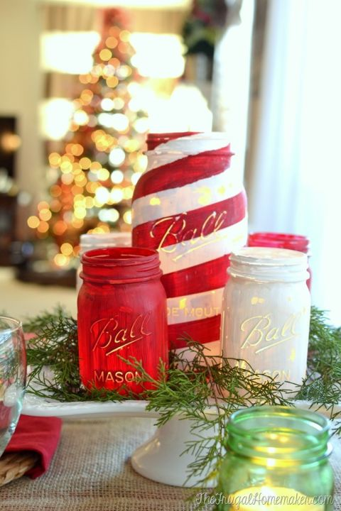Painted Mason jar luminaries are an easy way to add Christmas cheer to your dining table. Get the tutorial at The Frugal Homemaker.