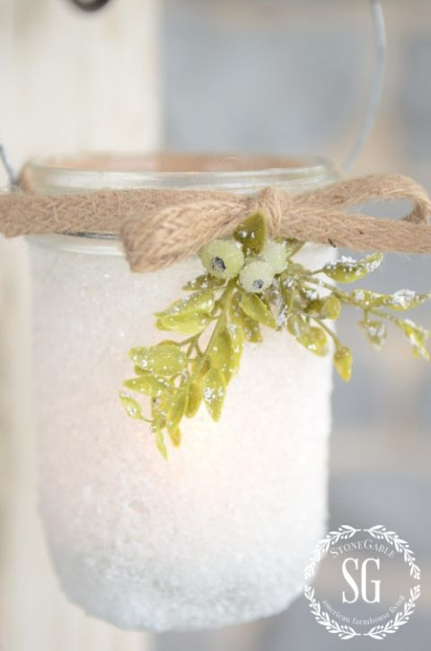 Add some class to your Christmas party by hanging these frosty votives on doorknobs. Get the tutorial at Stone Gable.