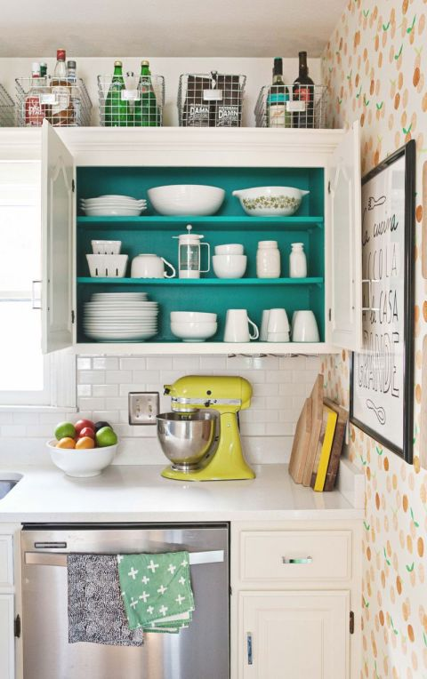 Easy-to-grab bins are great for corralling goodies on the tippy-top shelf. See more atA Beautiful Mess »