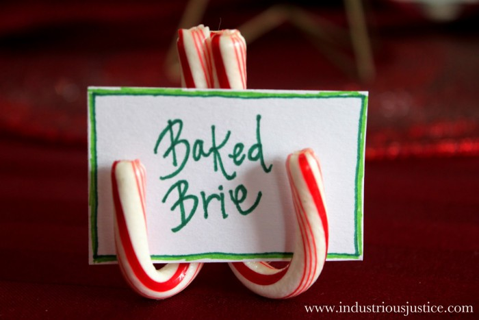Here, edible candy holders inform guests of the other tasty foods they get to devour during the holiday party. We think these crafts would look just as precious holding place cards at the dining room table. Get the tutorial at Industrious Justice »