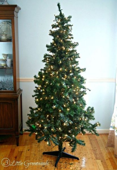 Use an extra string of artificial pine garland and wrap it around your tree — it'll blend seamlessly into the branches and conceal any bare spots that make your festive tree look lackluster. Get the tutorial at 3 Little Greenwoods »