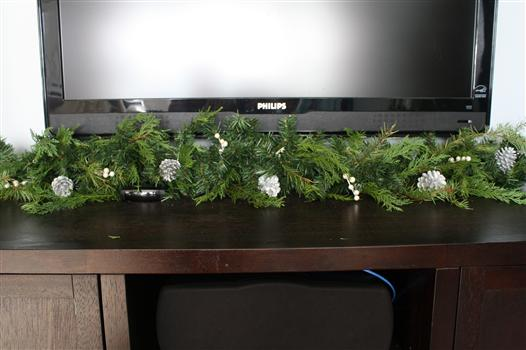 While this trick takes a little legwork, it looks so much more natural. Why? Because it involves doctoring your faux stuff real greenery from your yard. It's best of both worlds, really — part free and authentic, and part reusable for next year. See more of View Along the Way »