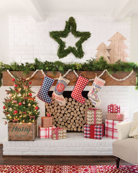 A wreath in the shape of a star, bright and cheery presents, and country-style stockings create the perfect Christmas scene.