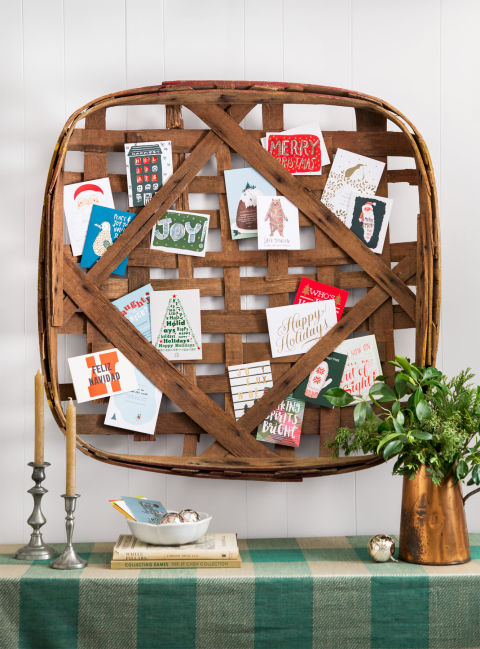 Show off the influx of season's greetings on a vintage tobacco basket by tucking well wishes into the overlapping strips of reed. (For old baskets, try eBay, Etsy, or CL Fair vendor Great Stuff By Paul).