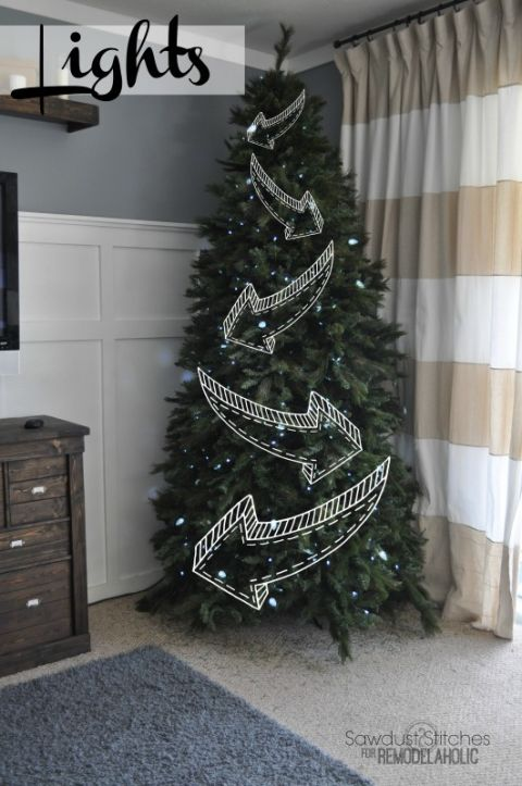 If your Christmas tree sits in a corner of your home, we've got good news: You don't have to wrap your string of lights back there. Instead just hang 'em from left to right in the front (and make sure the corners are tucked far enough in the back that no one can see them). Then, you'll have a fully lit tree — with half the cords. Get the tutorial at Remodelaholic »