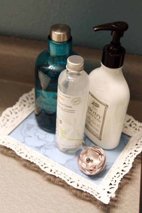 A bottle of white spray paint quickly brings life back to an old picture frame. Add a pop of color under the glass with some scrapbook paper, and you've got yourself a new vanity tray for your makeup and beauty products. Get the tutorial at I Heart Organizing.