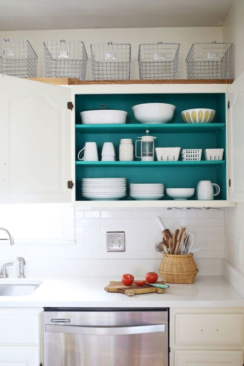 A sleek white kitchen is super stylish. But if you want to add a touch of personality, add color inside your organizers — this looks especially gorgeous when your dishes are white and pop against your color choice. See more at A Beautiful Mess »