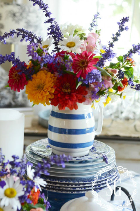 Don't have a vase around? Put freshly picked florals in a pitcher with a bold patten to really make them pop. See more at Stone Gable.