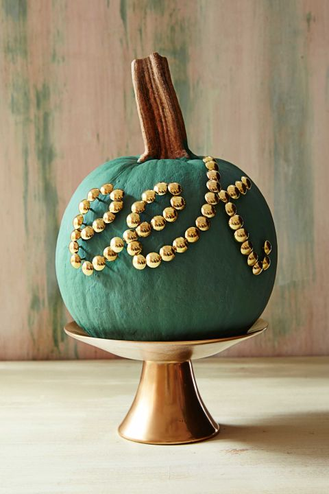 Create a tack-o'-lantern with this office store staple. Paint pumpkin desired color in a matte finish. Write letters with an erasable wax pencil, then use a hammer to tap in nailheads along the script. (The shorter the word, the more clearly it will read.)